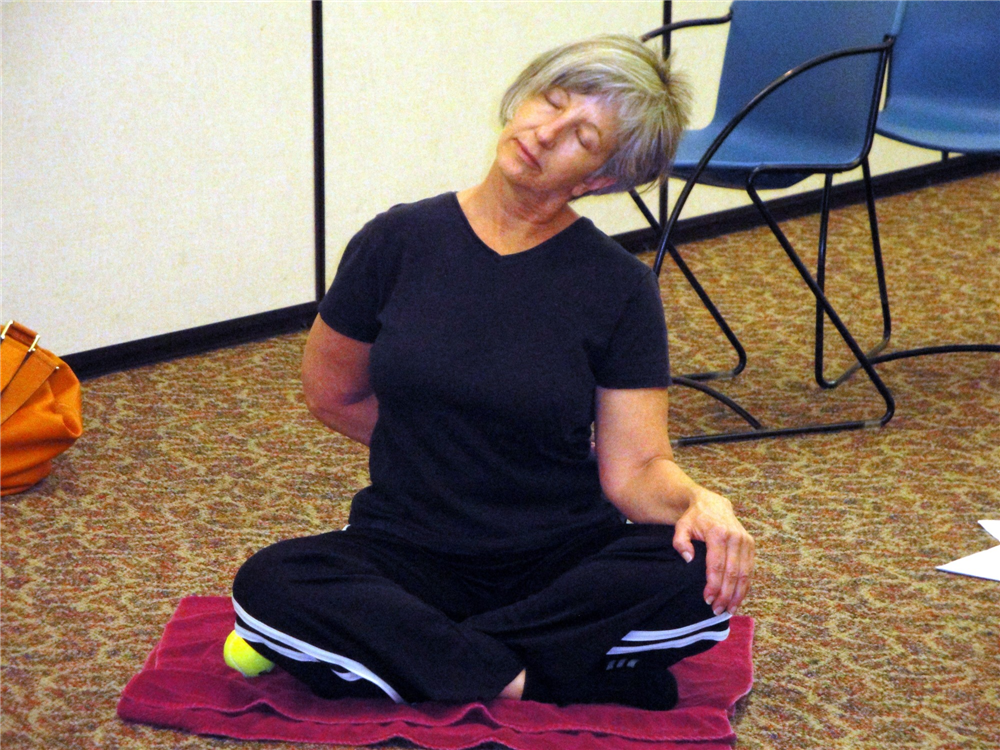 A trapezius stretch leads to a zen moment.